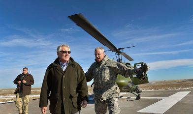 Secretary of Defense Chuck Hagel, center, is escorted by U.S. Air Force Gen. Jack Weinstein after arriving at the missile alert facility and launch control center at F.E. Warren Air Force Base in Cheyenne, Wyo., Jan. 9, 2014. Hagel was on a two-day trip to visit commands in the western United States.