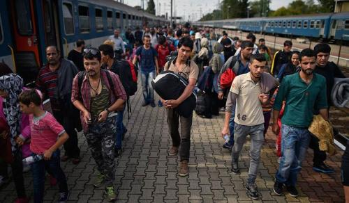 Migrants at a train station in Hegyeshalon, Hungary. (Jeff J. Mitchell/Getty)