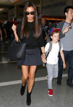 Victoria Beckham wearing Victoria Beckham Liberty Leather Tote Alaia Blow ankle boots