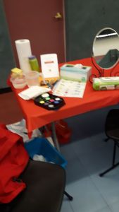 Face painting station by Lioness Brenda