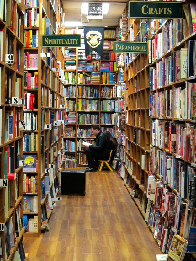 Man reading in book aisle in Russell Books