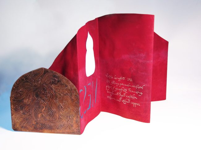 Accordion book on vellum with acid etched copper covers (open, back)