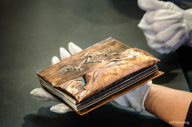 Imagination Bodies Forth, Eastern repousse copper bound artist book with hand lettering (being shown by Victoria)