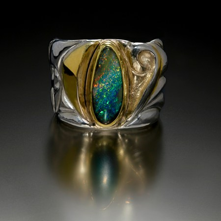 Enveloped IV, Eastern repousse and kum boo ring with Koroit opal by Victoria Lansford; photo by Pat Vasquez-Cunningham
