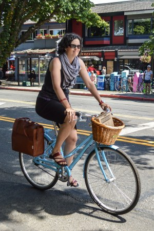cycling through Cook St. Village [photo: Chris Bruntlett]