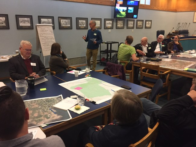 Ray Straatsma introduces the charrette group work.