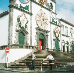 Two men enjoying the afternoon in front of the Church in Villa Franca