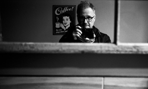 """I spend lots of time in cafes. I love the atmosphere there. People are happy, relaxed, doing something they too love. I shot this into a mirror, the scan is """"backwards"""" but that's ok. I don't take many images of myself, I am not comfortable in front of the camera."""