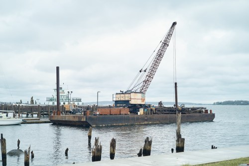 This barge is being used to install dock pilings for the Town's expanded waterfront.