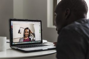 Man and women having a video chat