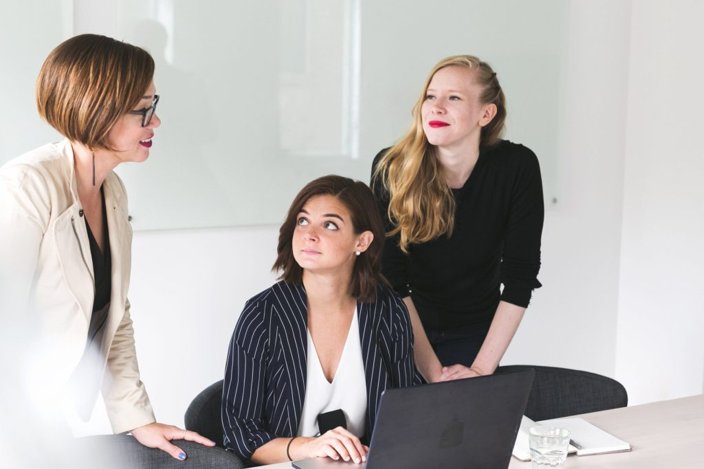 Three business women working together