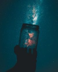 Image of galaxy coming out of a mason jar.