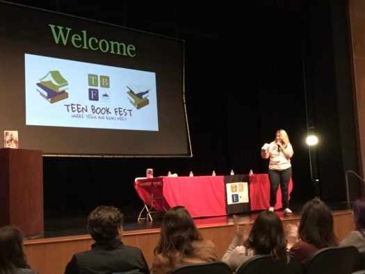 Image of Ontario City Library's Courtney Saldana welcoming the audience to the Ontario Teen Book Fest 2019.