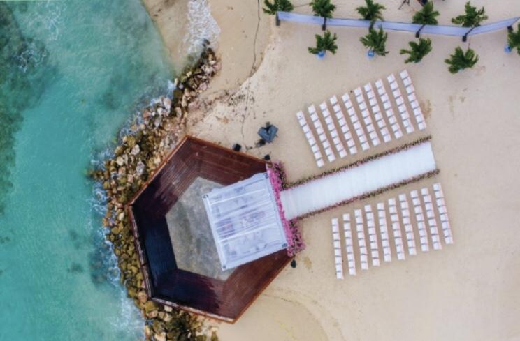 Drone view of a beach wedding at Curacao Marriott Beach Resort