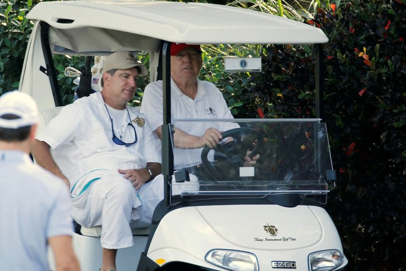 US President Donald Trump arrives to play host to members of the US Coast Guard he invited to play golf at his Trump International Golf Club in West Palm Beach, Florida, on December 29, 2017. (Reuters)