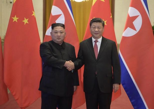 الرئيس الصيني و زعيم كوريا الشمالية