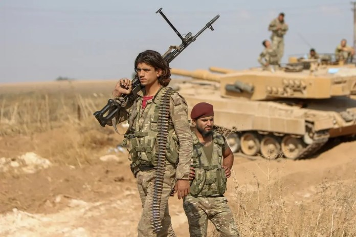 Fighters loyal to Ankara in Syria - AFP