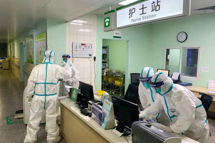 Protective clothing in a Wuhan hospital