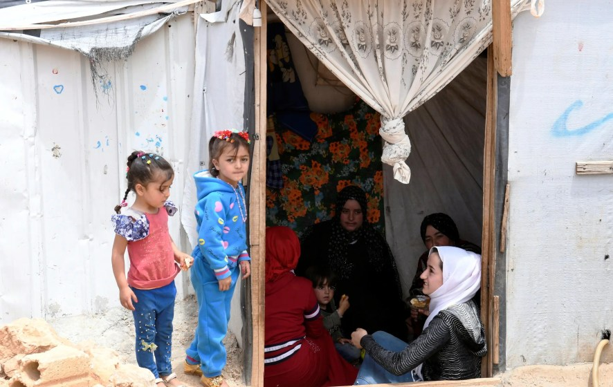 Syrian refugees sit together in a tent at the Lebanese border town of Arsal. (File photo: Reuters)