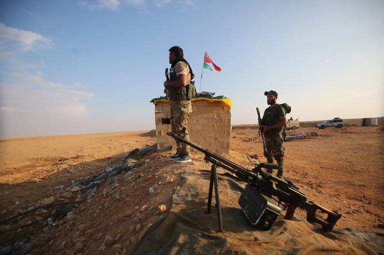 Iraqi Shia fighters of the PMU militias secure the border in al-Qaim in the Anbar province, opposite Albukamal in Syria's Deir Ezzor region. (File photo: AFP)
