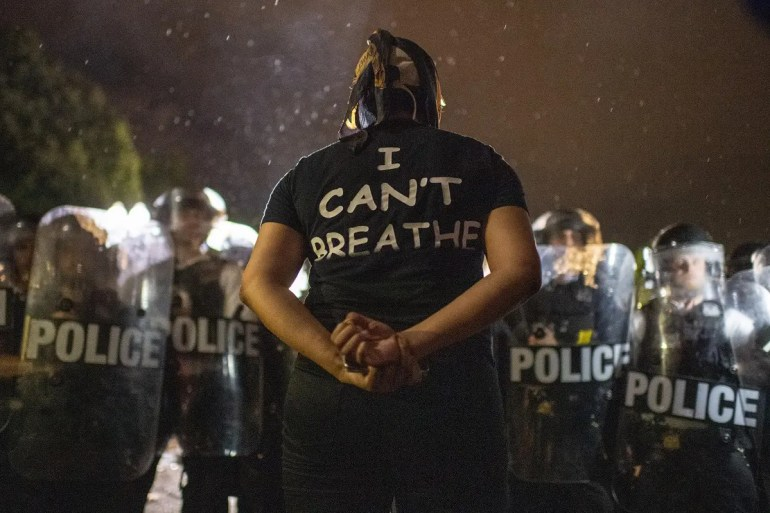 Protesters face off with police outside the White House in Washington, DC, early on May 30, 2020 during a demonstration over the death of George Floyd. (AFP)