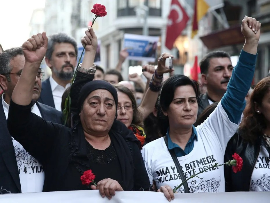 Mothers of Berkin Elvan and Ethem Sarisuluk attend a demonstration to mark the fourth anniversary of the Gezi Park protests in central Istanbul. (Reuters)