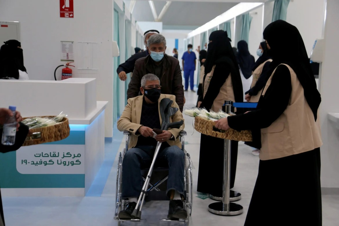 A man in a wheelchair leaving after he received dose of a coronavirus disease (COVID-19) vaccine, in Riyadh, Saudi Arabia December 17, 2020. (Reuters)