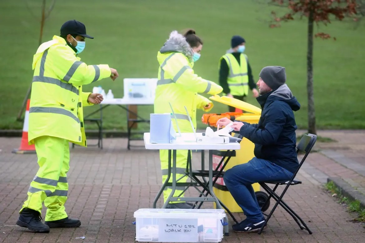 A health worker talks with a man taking a swab test in Goldsworth Park, as the South African variant of the novel coronavirus is reported in parts of Surrey, in Woking, Britain, on February 1, 2021. (File photo: Reuters)