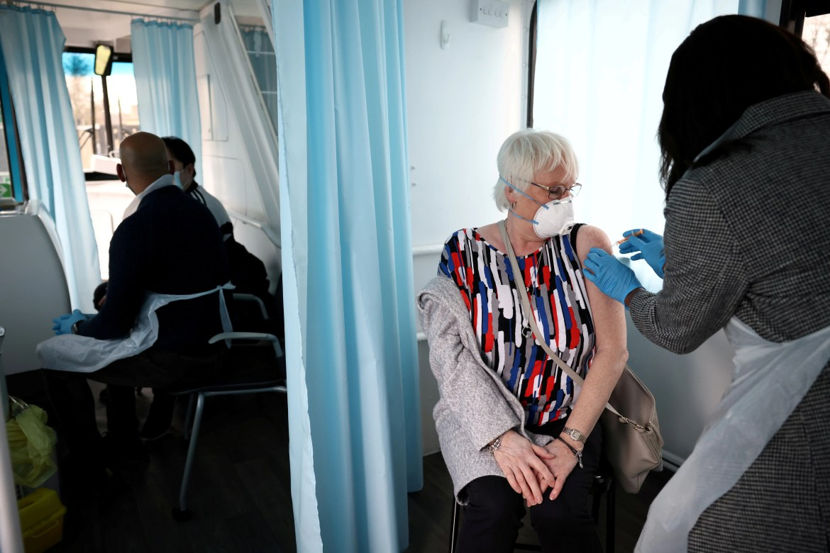 A woman receives a dose of the Oxford-AstraZeneca COVID-19 vaccine in Thamesmead, London, Britain. (Reuters)