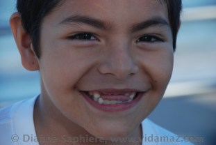 Closeup of Luis' too-cute toothless grin.
