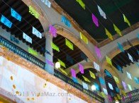 Papel picado hanging over the altar, from the second floor ceiling
