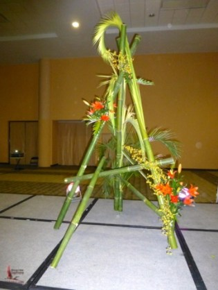 Two huge ikebana arrangements at the front of the main hall
