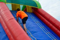 Danny seeming to just walk up the inflatable. Youth!