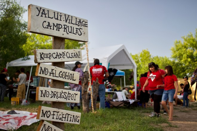 Camp rules at Yalui Village, where roughly 50 tribal members and allies gathered last summer for ceremony and to welcome guests from Alaska's Gwich'in commumity touring a documentary of their own resistance to federal energy projects.