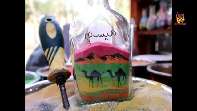 الرسم بالرمل على الزجاج .. فن نوبي يعشقه السياح بمصر
