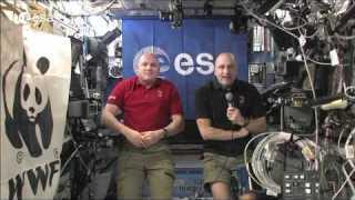ESA astronaut Andr? Kuipers and astronaut Don Pettit greet WWF