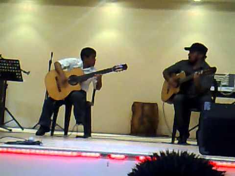 Julio Silpitucla with his teacher: Tico Tico