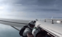Skydiver Gets Knocked Out Friends Pull His Chute For Him