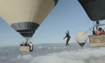 Guys Walk Tight Rope Between Two Hot Air Balloons