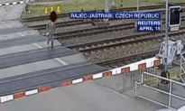 Speeding Train Gives Old Man a Love Tap