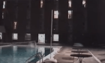 Insane Kid Jumps Off Roof Into Shallow Pool