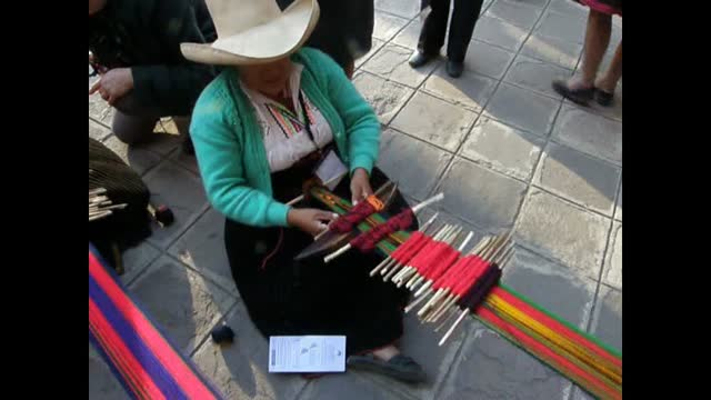 operating two sets of heddles
