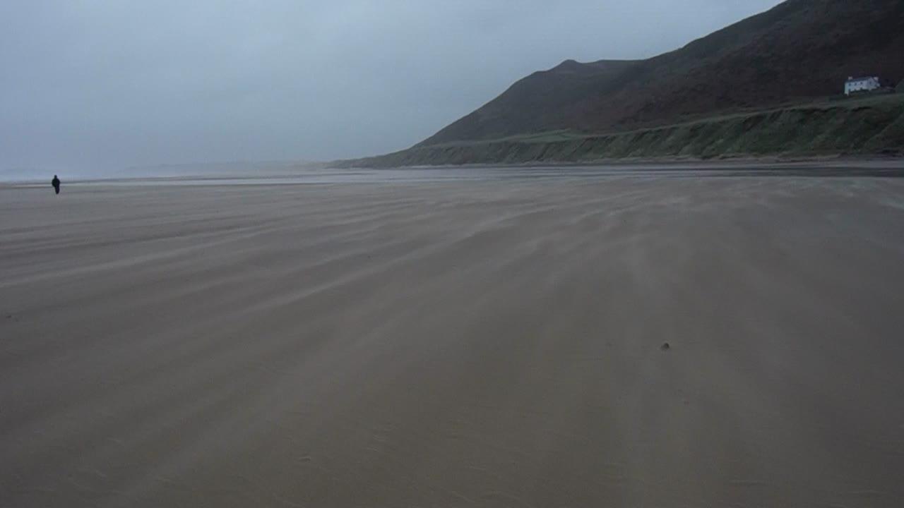 Wind blowing sand across Rhossili Beach