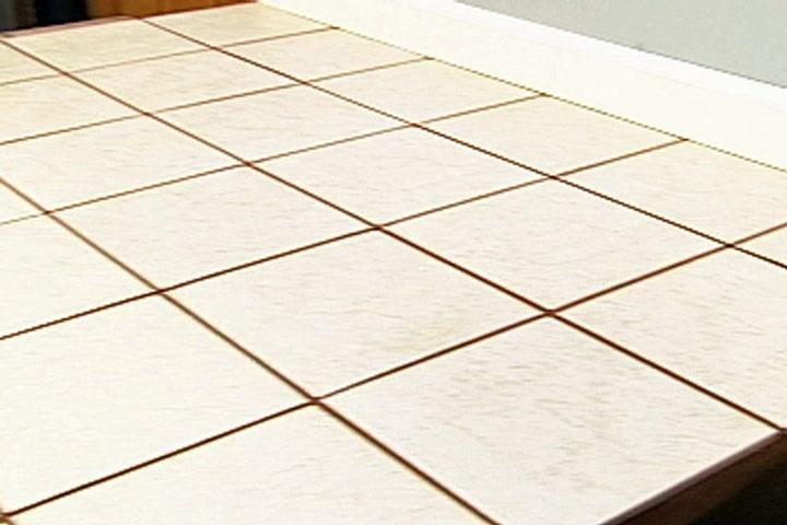 how to install ceramic tile over vinyl flooring