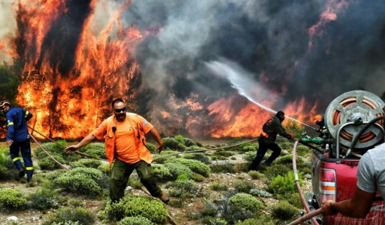 Greece wildfire: At least 74 dead, 300 cars charred as rescue ops continue