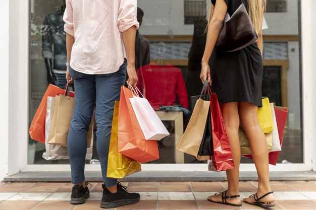 man & woman are shopping