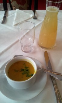The lentil soup and apple juice with soda