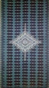 Sarape tejido con hilos teñidos en añil y nuez.