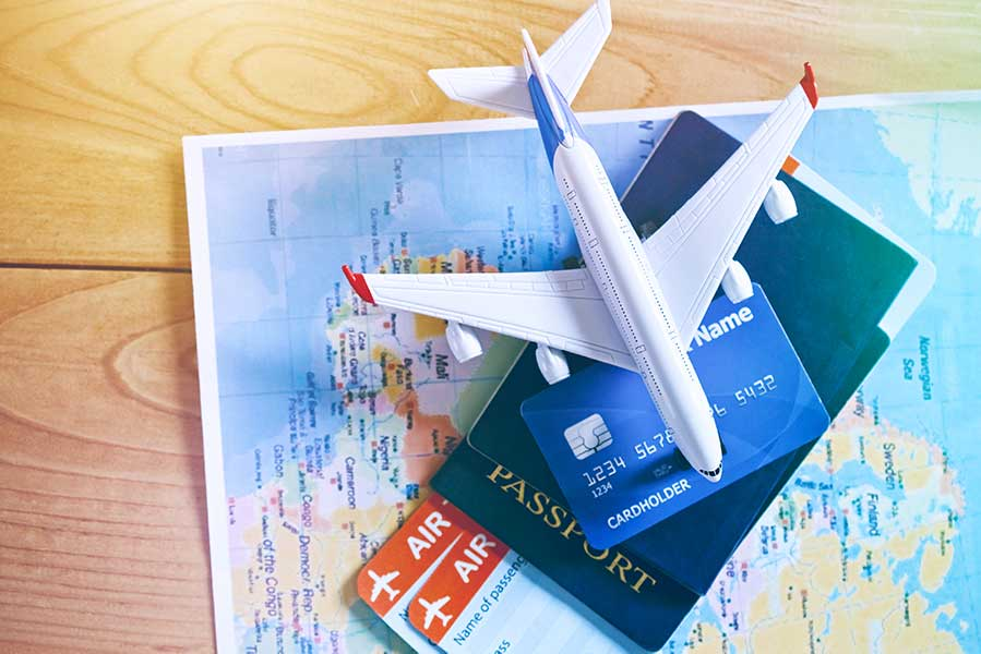 Air tickets, passports and credit card on world map