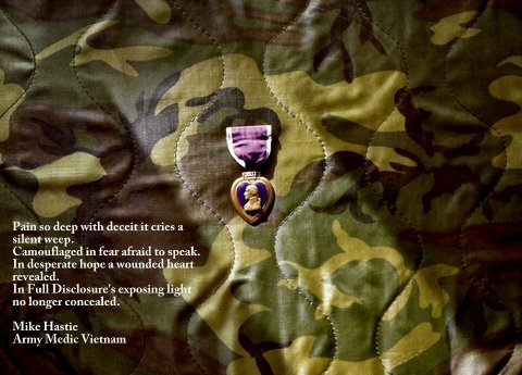 Purple Heart medal on camoflage background
